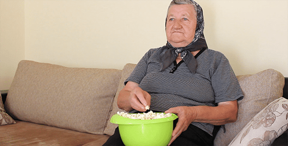grandmother%20eating%20popcorn%20from%20the%20bowl-preview.png