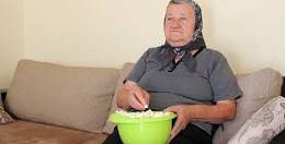 Old Lady Eating Popcorn.jpg